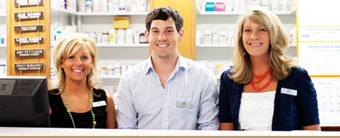 Smiling pharmacists at work